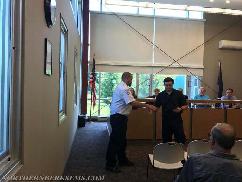 Northern Berks EMS EMT Jesiah Newsome shaking hands with Executive Director Stephen Bobella Jr. and receiving his Heart Saver Hero award.